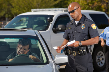 Police officer handing a driver a ticket
