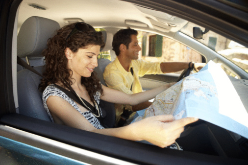 Couple Driving in Car with a Map