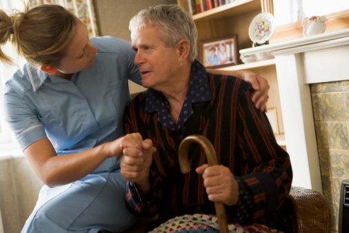 Nurse Assisting Elderly Man