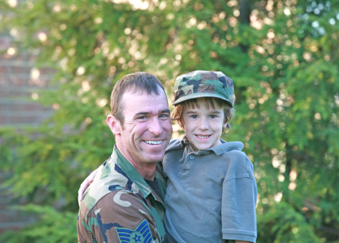 Military Father Posing for a Picture with Son