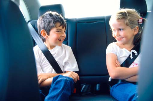 Young Siblings Sitting in the Backseat of a Car