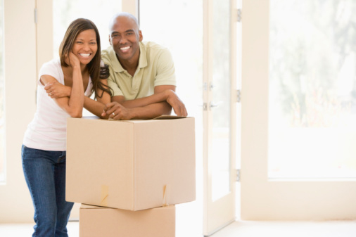 Couple in new home with moving boxes