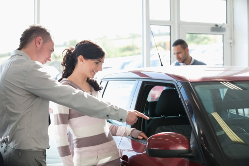 Car Salesman Showing Woman New Car