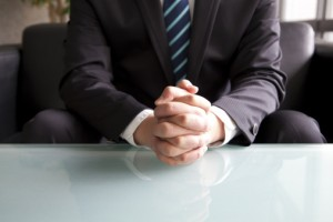 Hand of Businessman Waiting Patiently in a Job Interview