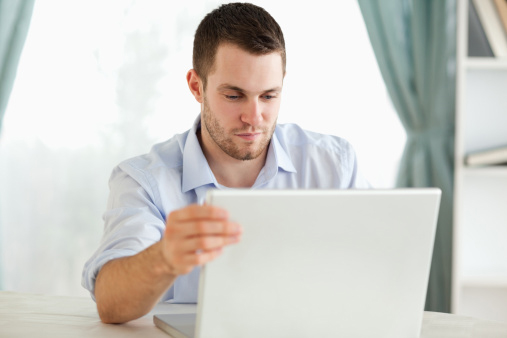 Man Researching on Laptop