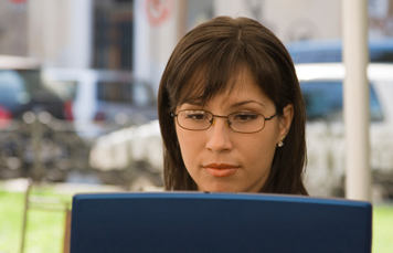 Woman On Laptop Running a Background Check