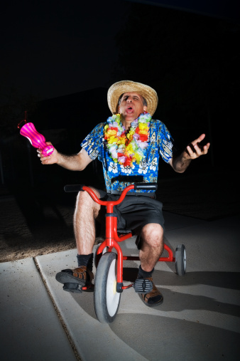 Drunk looking man on tricycle
